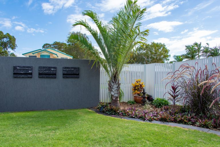 Bribie Island bathroom renovation landscape design and a modern fence