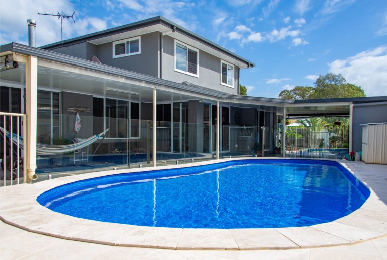 Bribie Island pool with crystal clear sky blue water built by Turul Builders