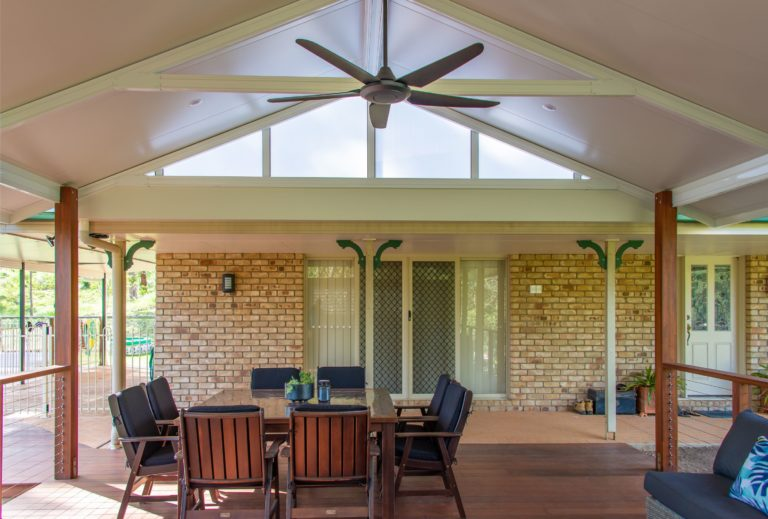 Warner Deck Extension Undercover Deck with Ceiling Fan and Table with Chairs