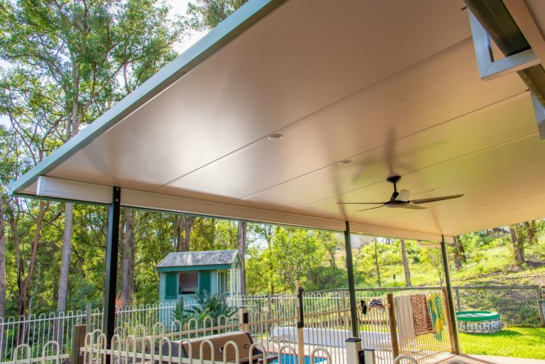 Warner deck extension view of ceiling fan and shed in the background