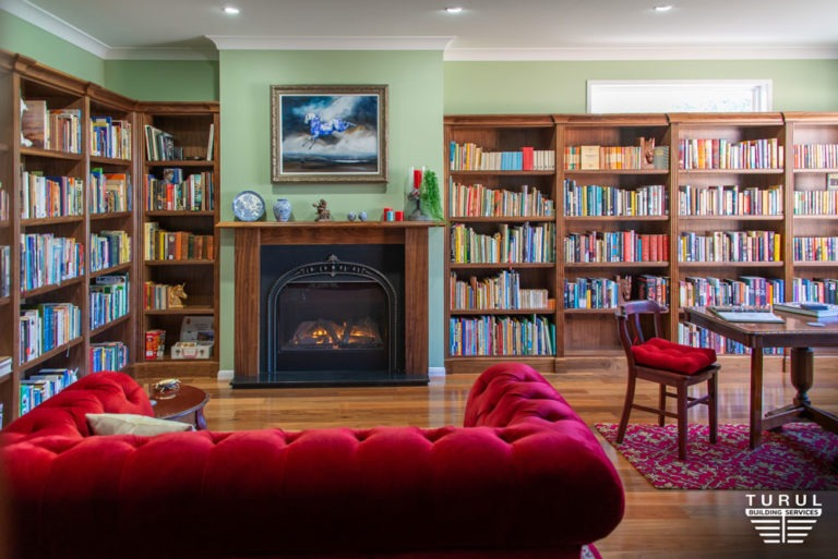 Burpengary Private Library Build Fireplace with Couch and Bookshelves