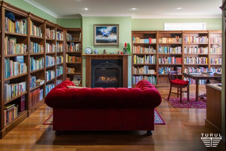 Burpengary Private Library Build - Bookshelves with Fireplace and Couch