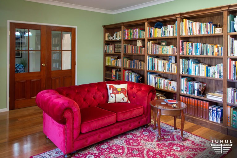 Burpengary Private Library Entrance Seen from the Inside with Couch and Bookshelves